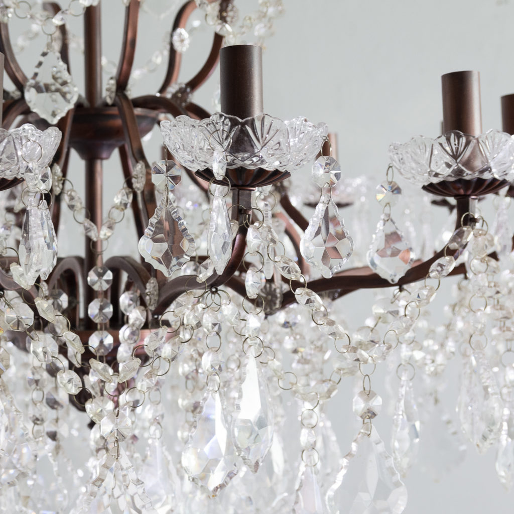 Twelve light glass lustre and bronzed metal chandeliers, -131590