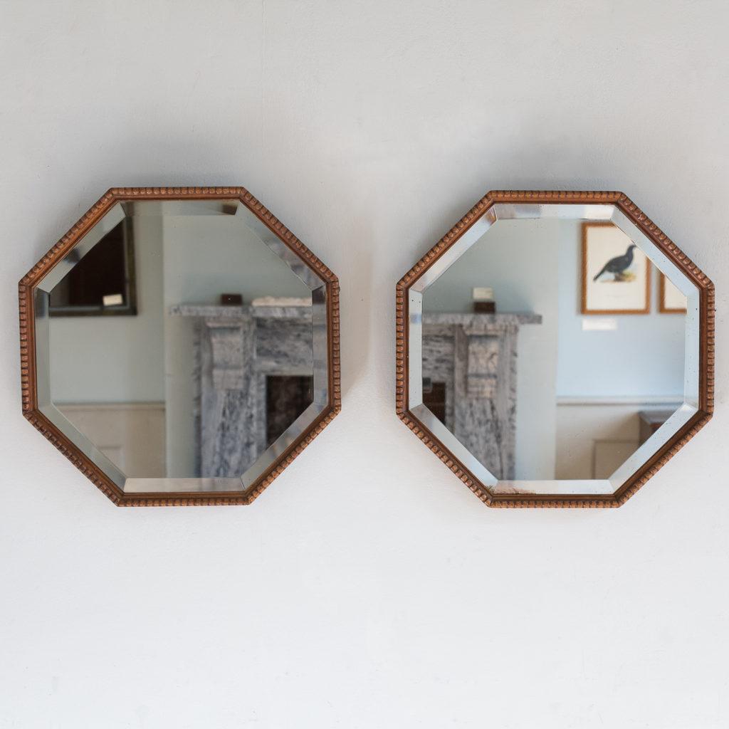 Pair of 1920s octagonal mirrors,