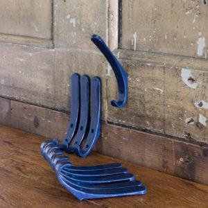 Blue plastic school coat hooks