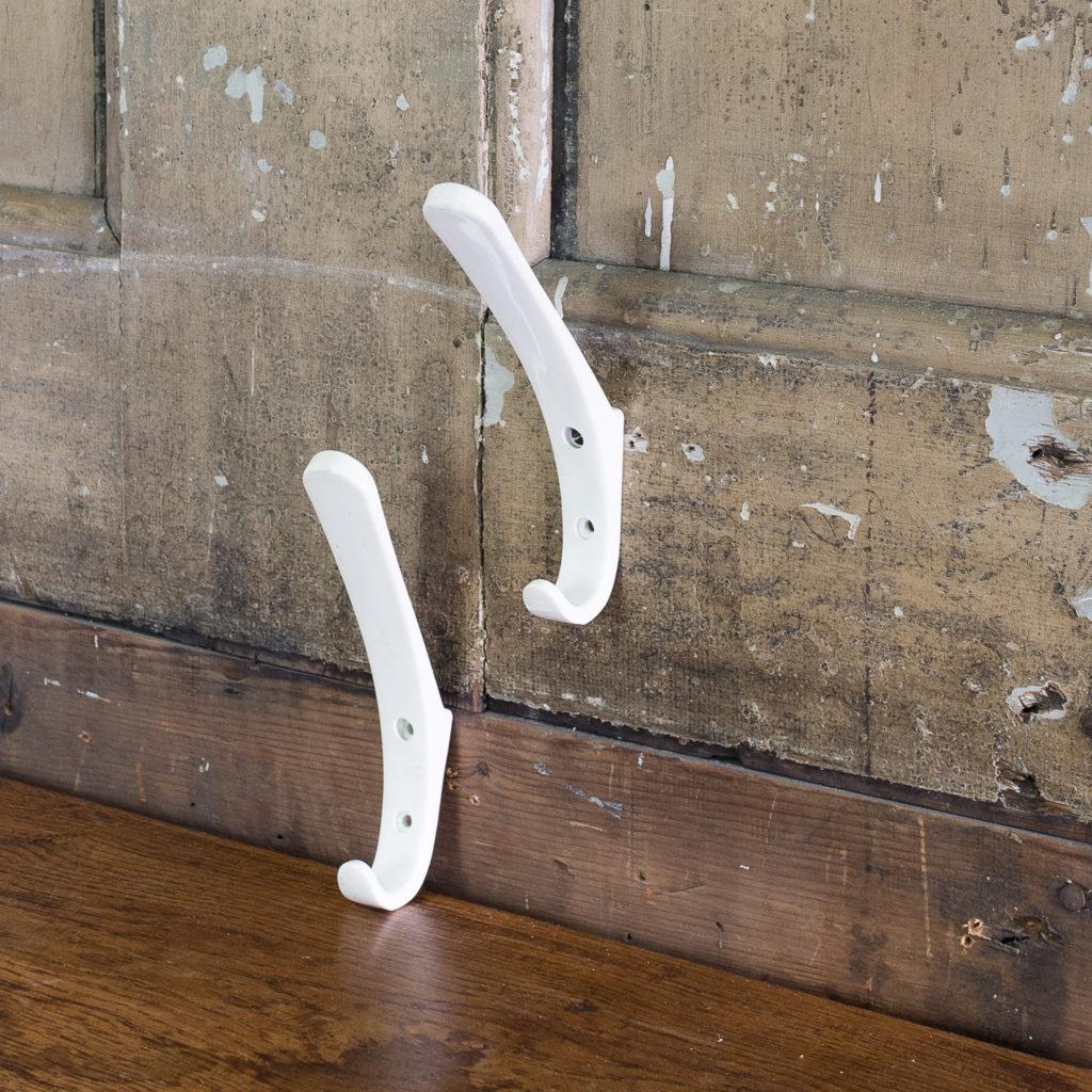 White plastic school coat hooks
