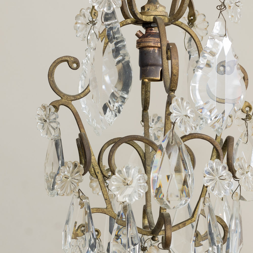 the frame hung with an arrangement of moulded glass droplets,