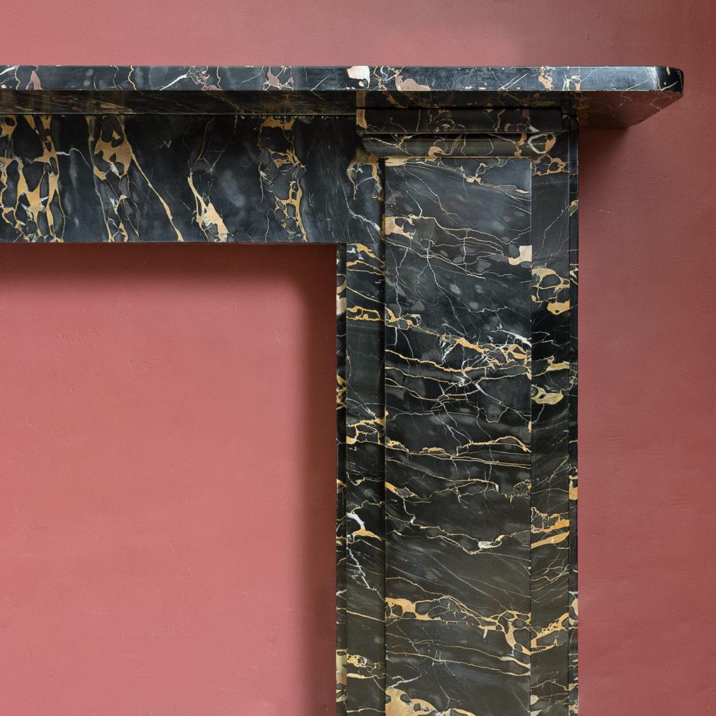 Nineteenth century Portoro marble chimneypiece,