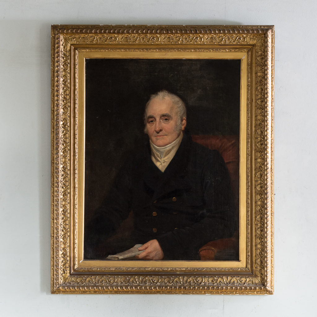 Portrait of a seated a gentleman holding papers