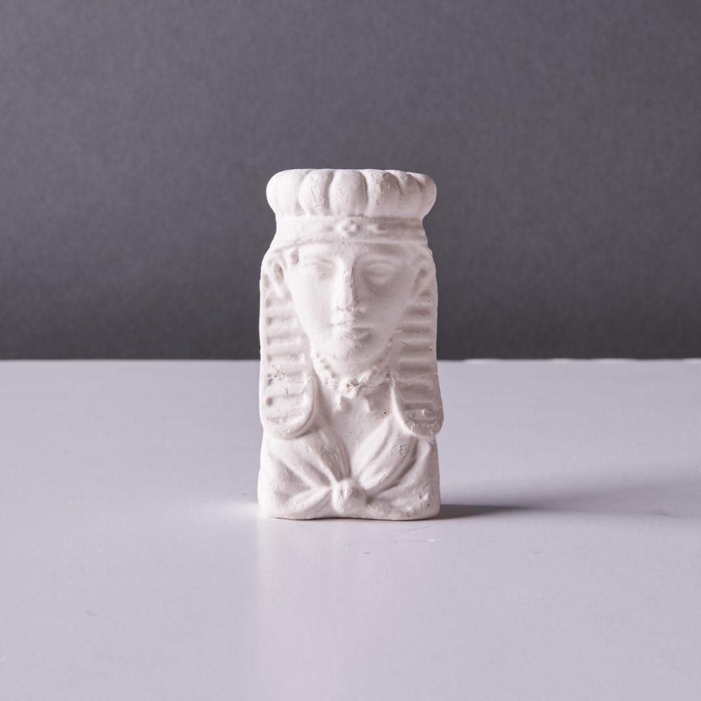 A plaster cast of an Egyptian head,-0