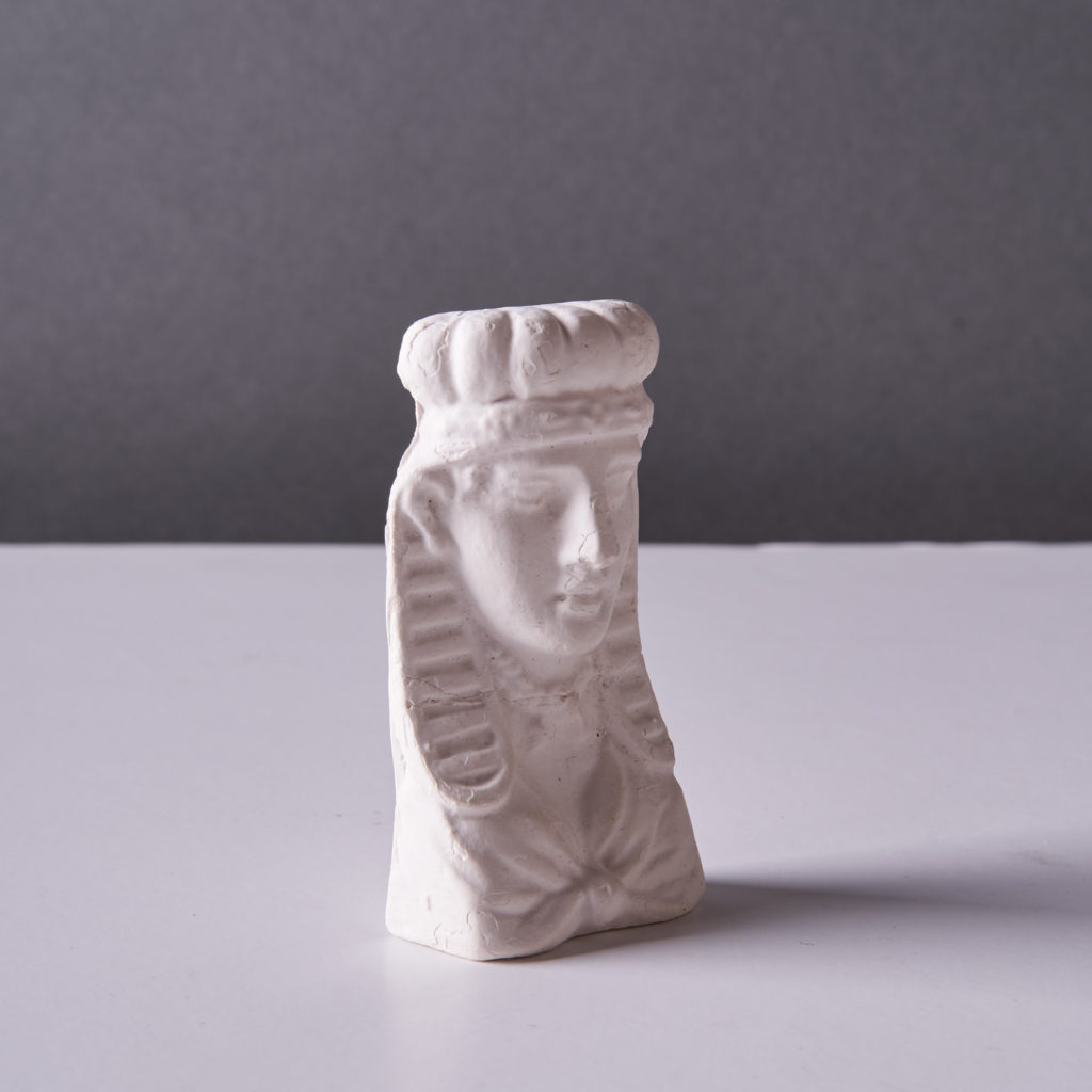 A plaster cast of an Egyptian head,-134192