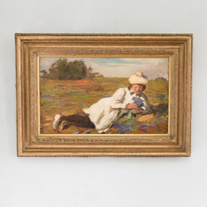 Edwardian oil on canvas of a reclining lady,