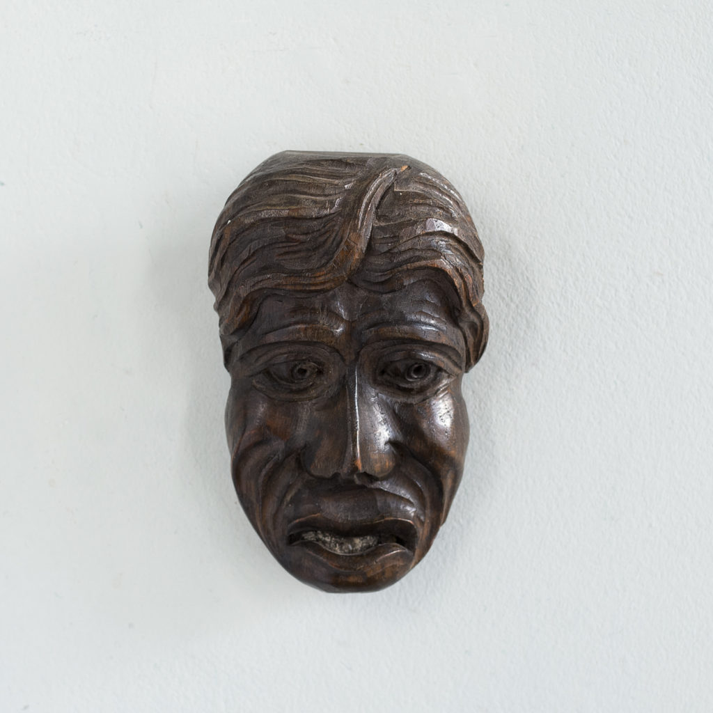 Early twentieth century carved oak grotesque mask,