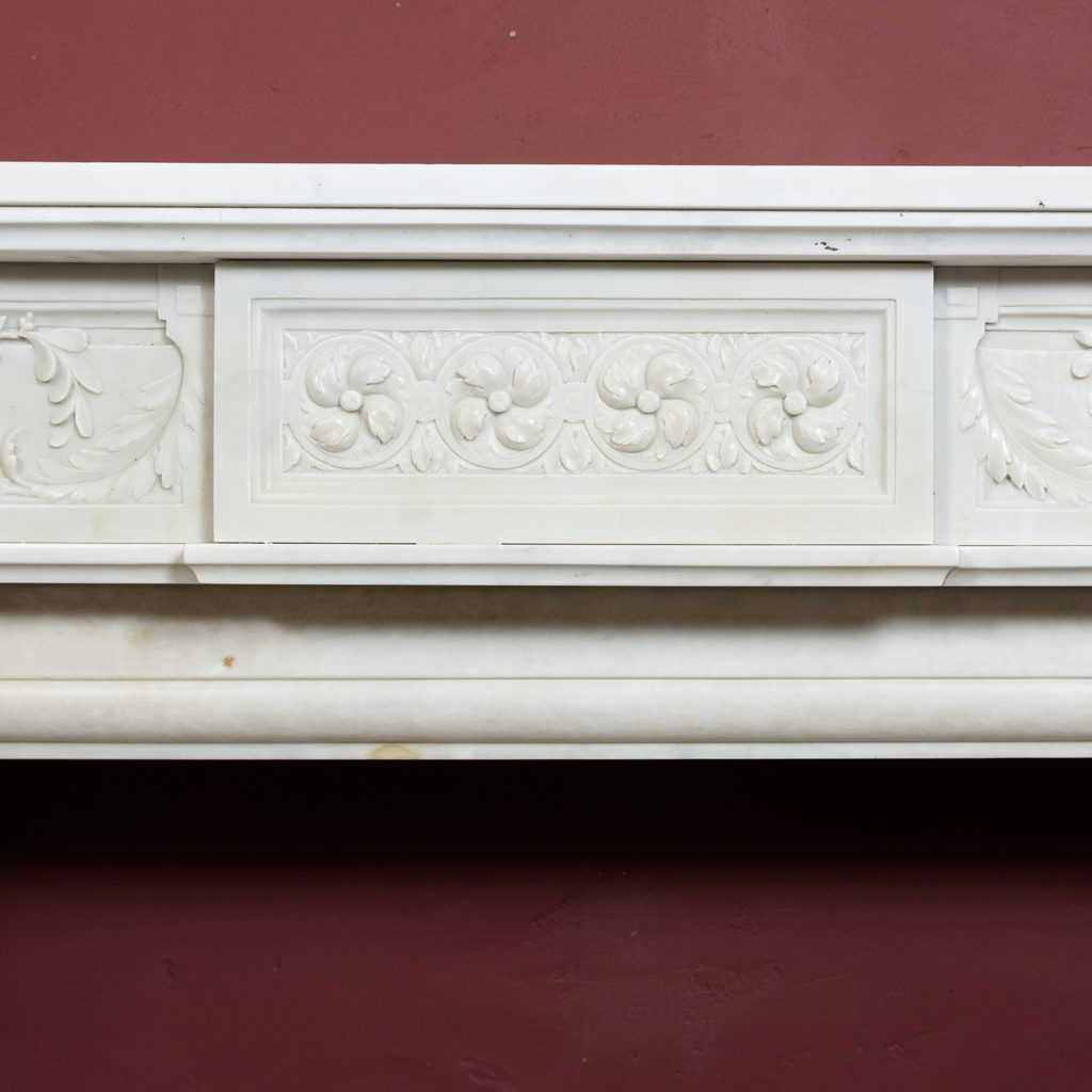 frieze centred by plaque with foliate roundels with scrolling foliage to either side