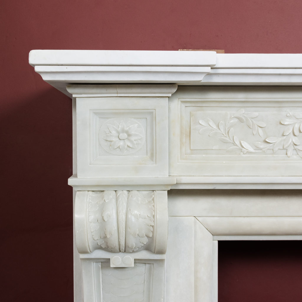 the jambs headed by paterae endblocks above foliate carved corbels,