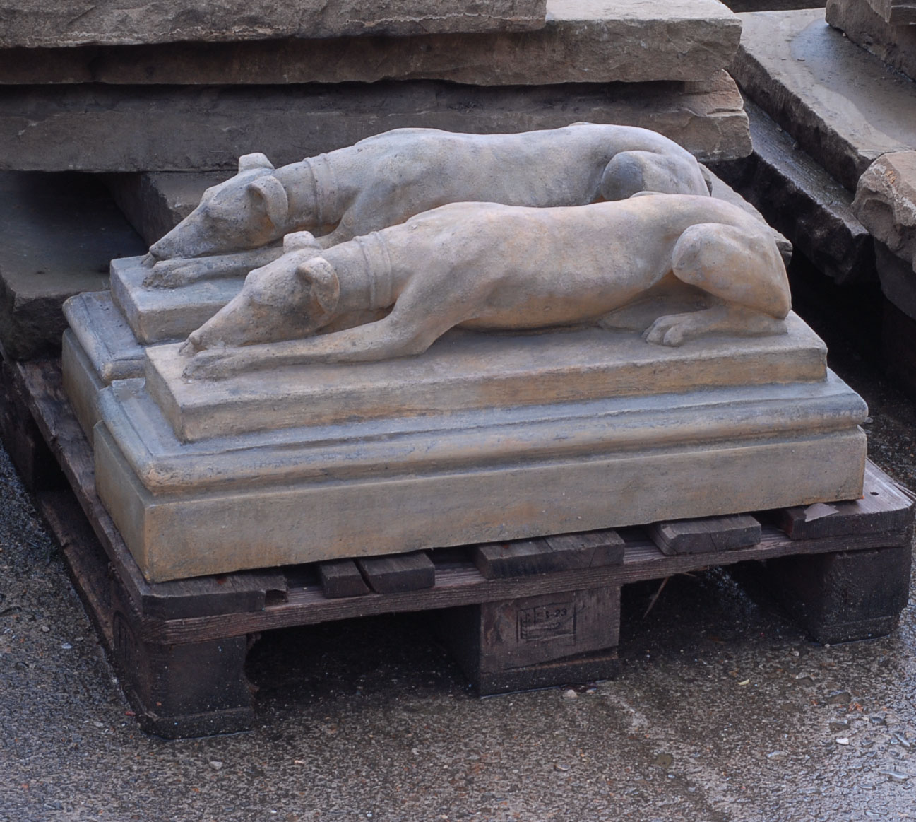 An English composition stone recumbent whippet on plinth-138674