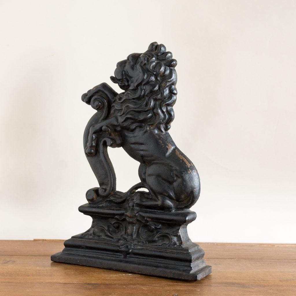 Pair of late Victorian rampant lion cast iron door stops,-134874