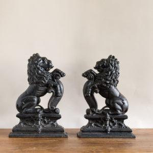 Pair of late Victorian rampant lion cast iron door stops,
