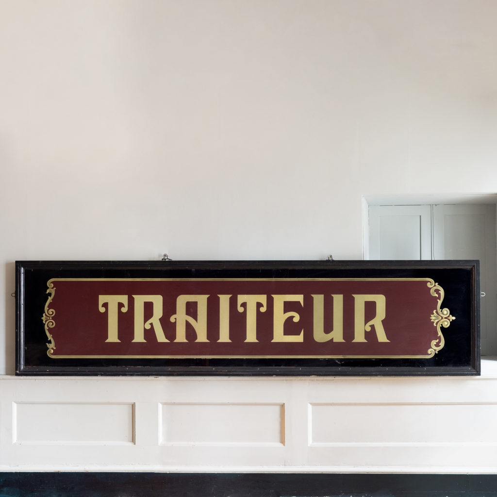 Large early twentieth century French reverse painted caterers signboard,