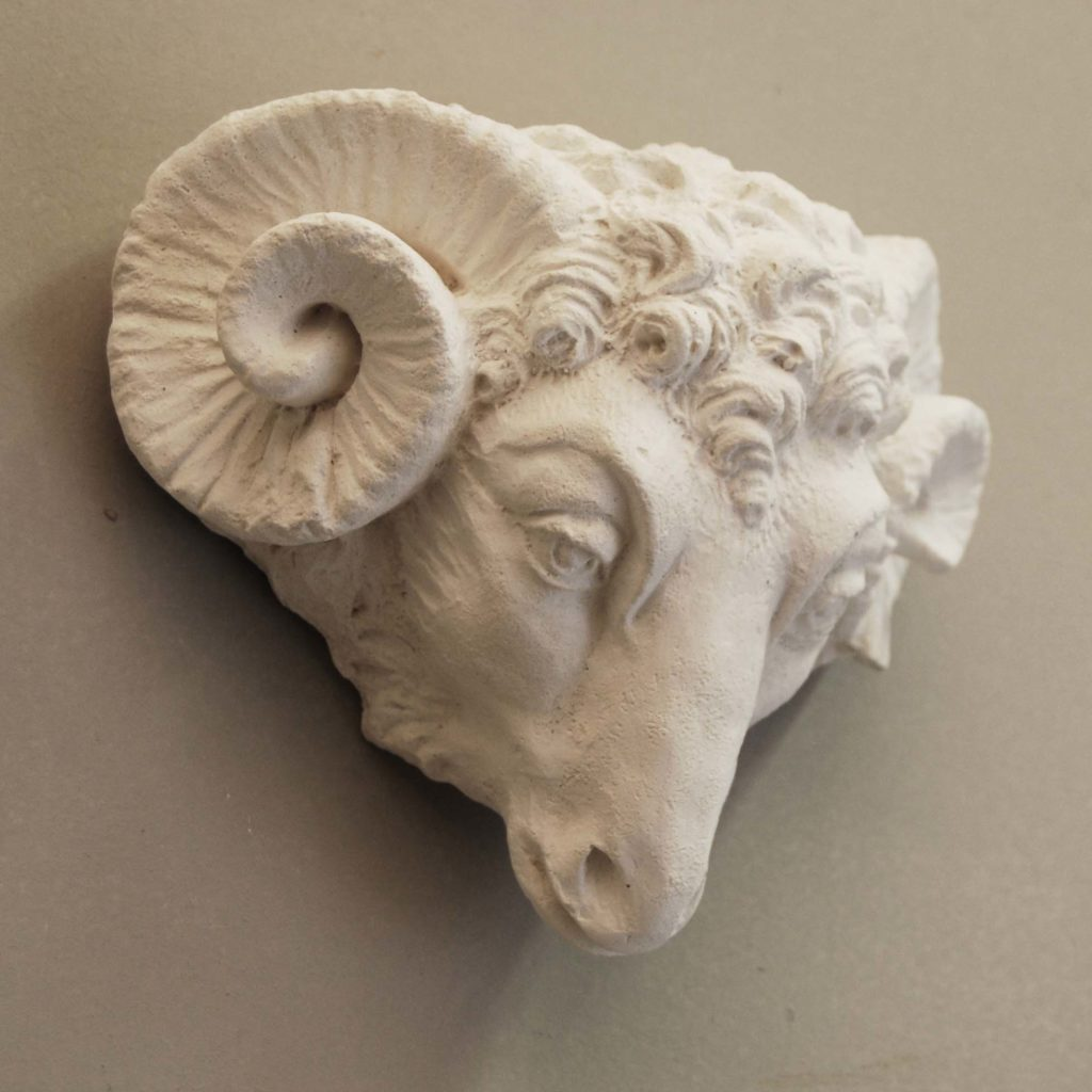 An English cast plaster head of a ram-135736