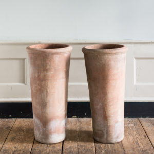 Tapered cylindrical terracotta planters,