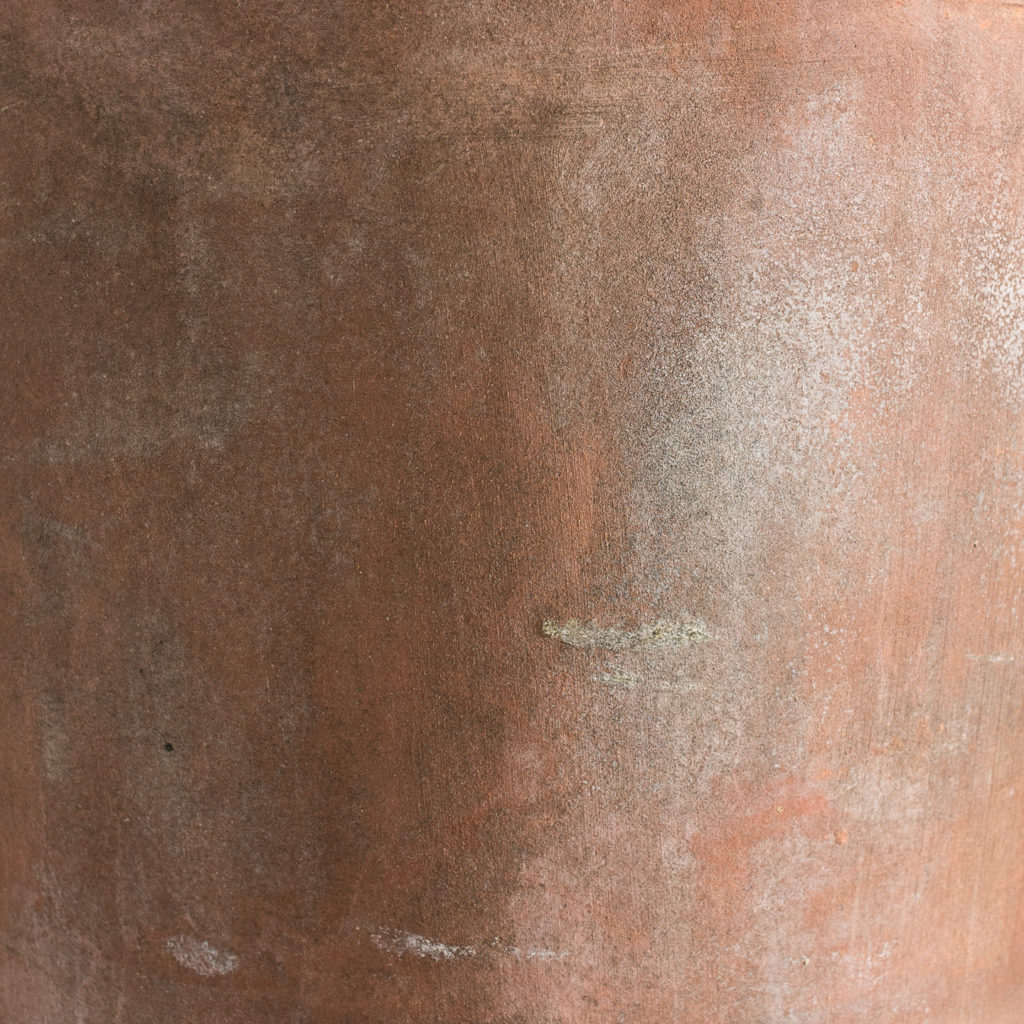 Two tapered cylindrical terracotta planters,-136090