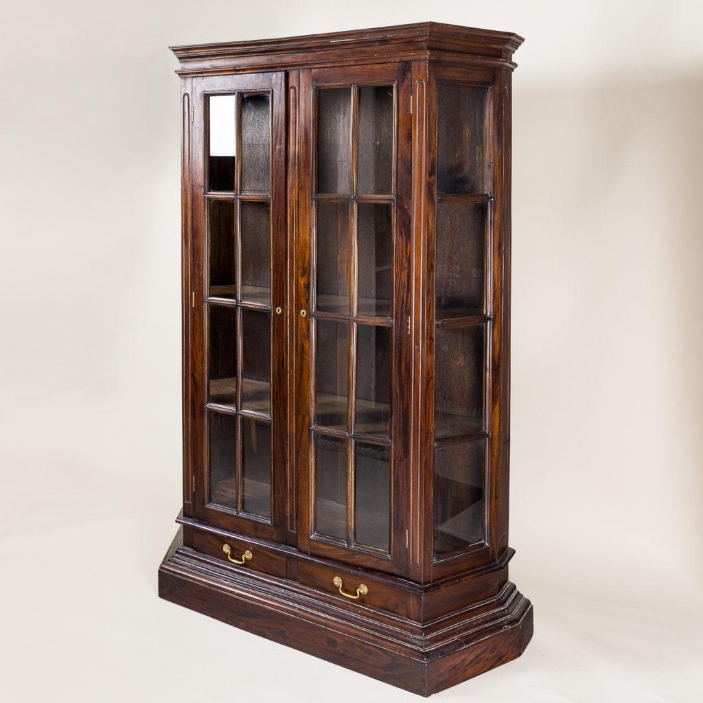 Twentieth century Indian hardwood and glazed display cabinet,