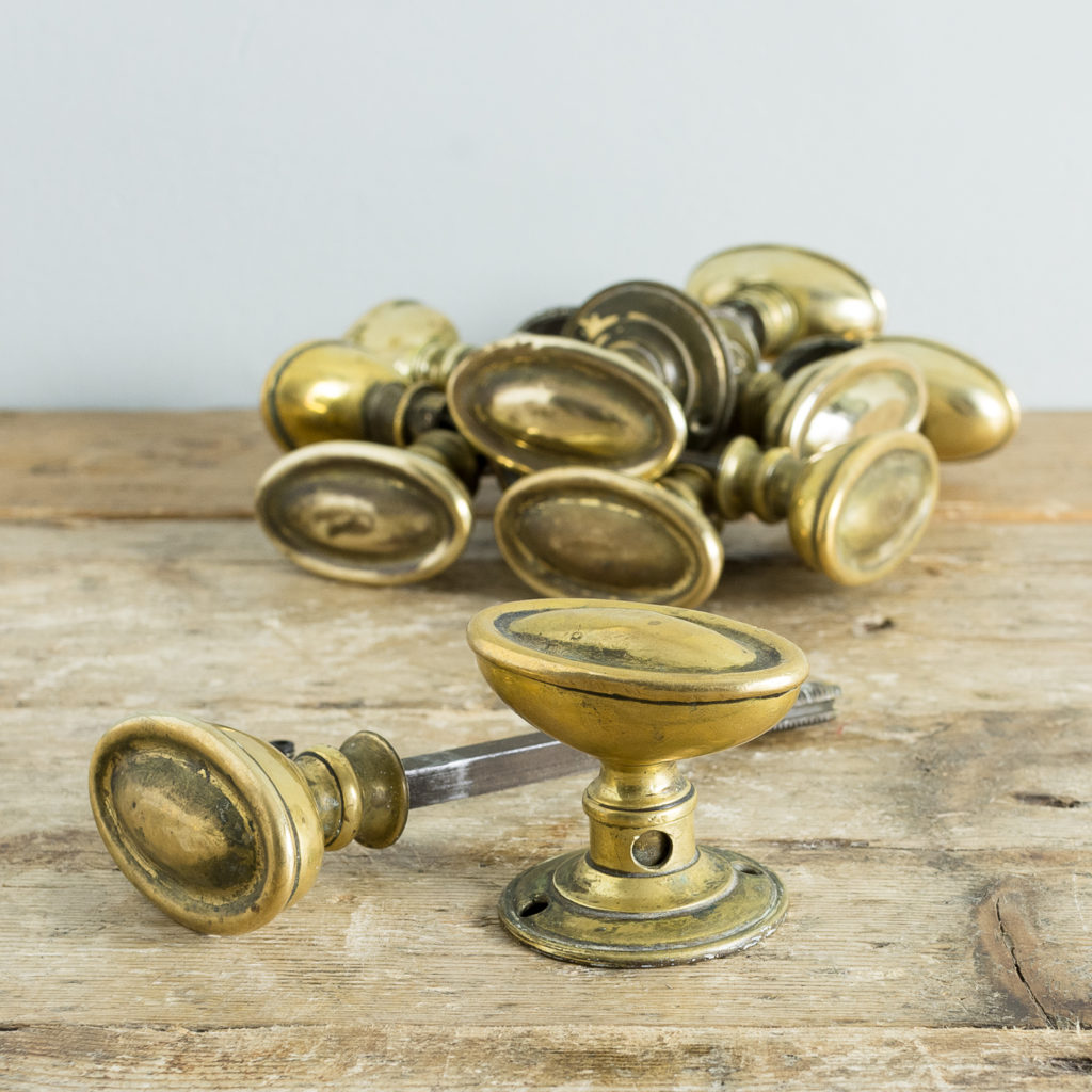 Edwardian pressed brass rim lock oval door knobs,