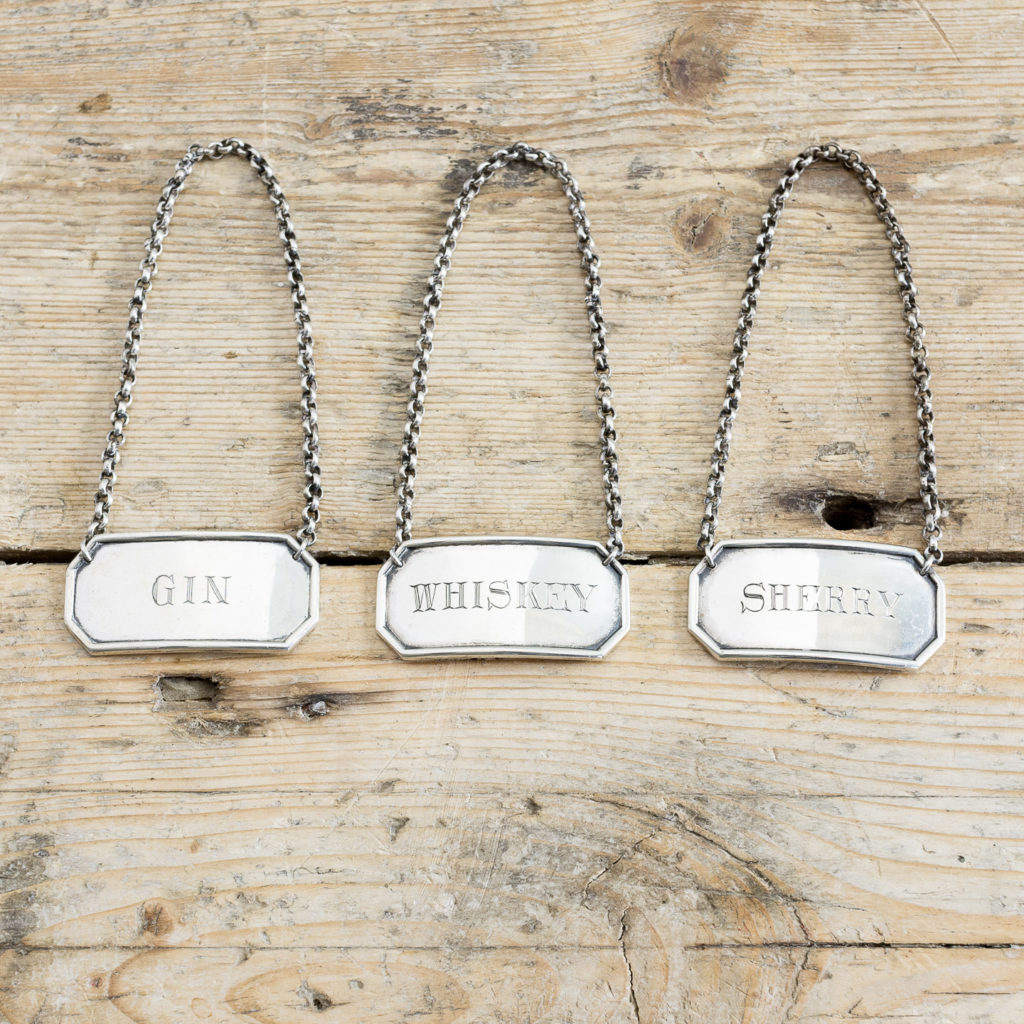 Set of three silver decanter labels
