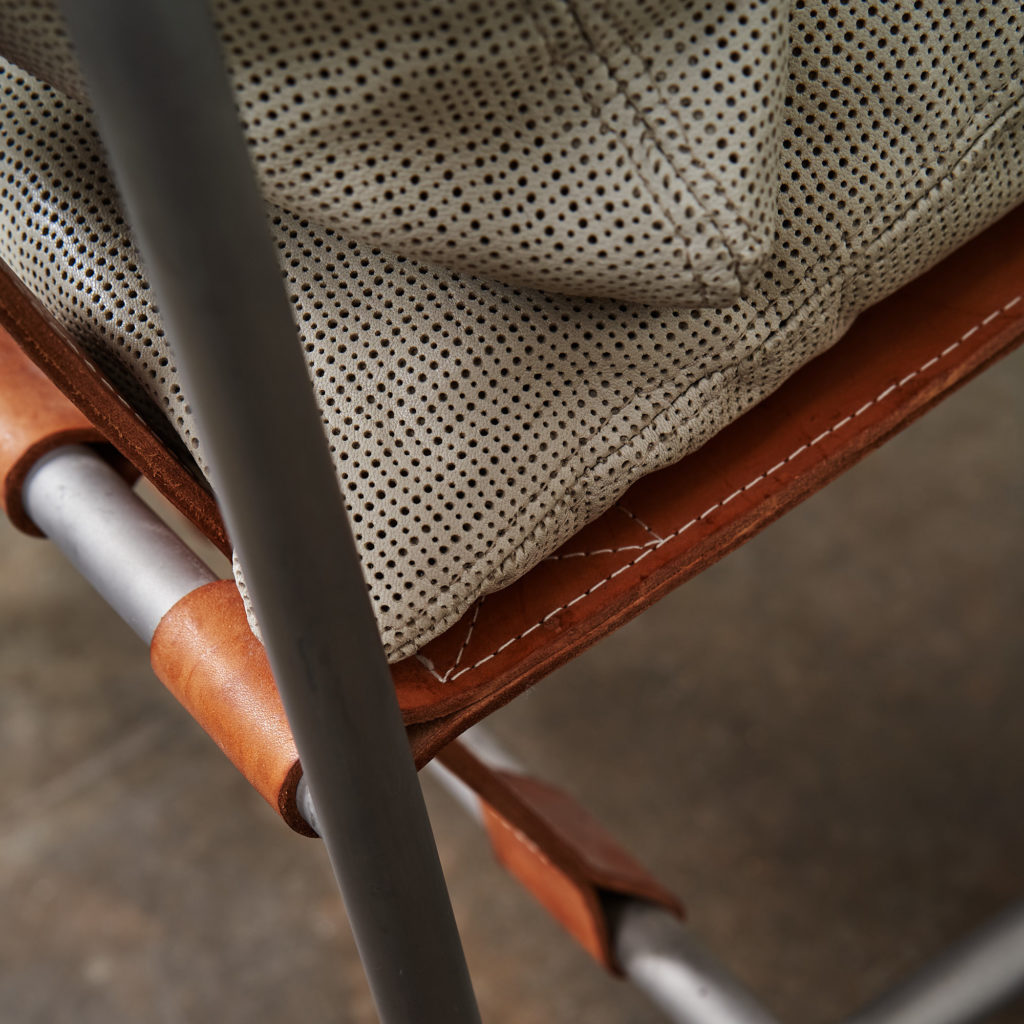 Steel framed lounge chair with leather straps,-136671