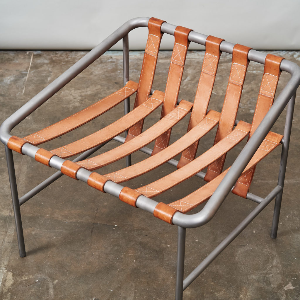 Steel framed lounge chair with leather straps,-136673