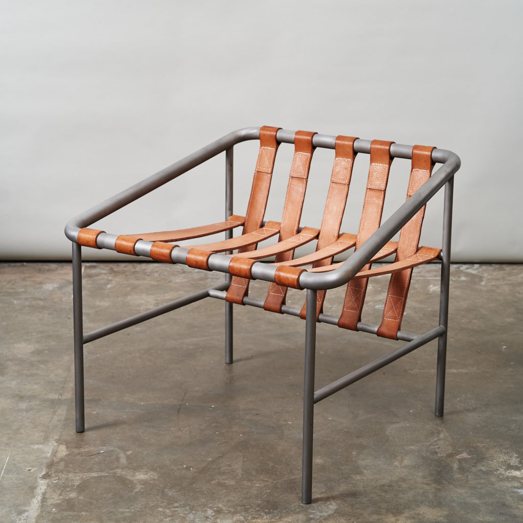 Steel framed lounge chair with leather straps,-136674