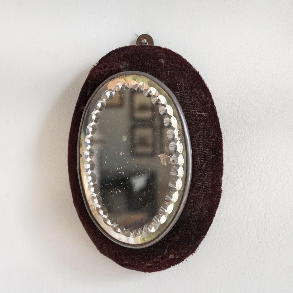 Small Edwardian cut glass oval mirror,