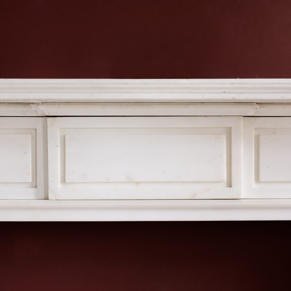 the moulded shelf above frieze with incised channel-moulded decoration and central plaque,