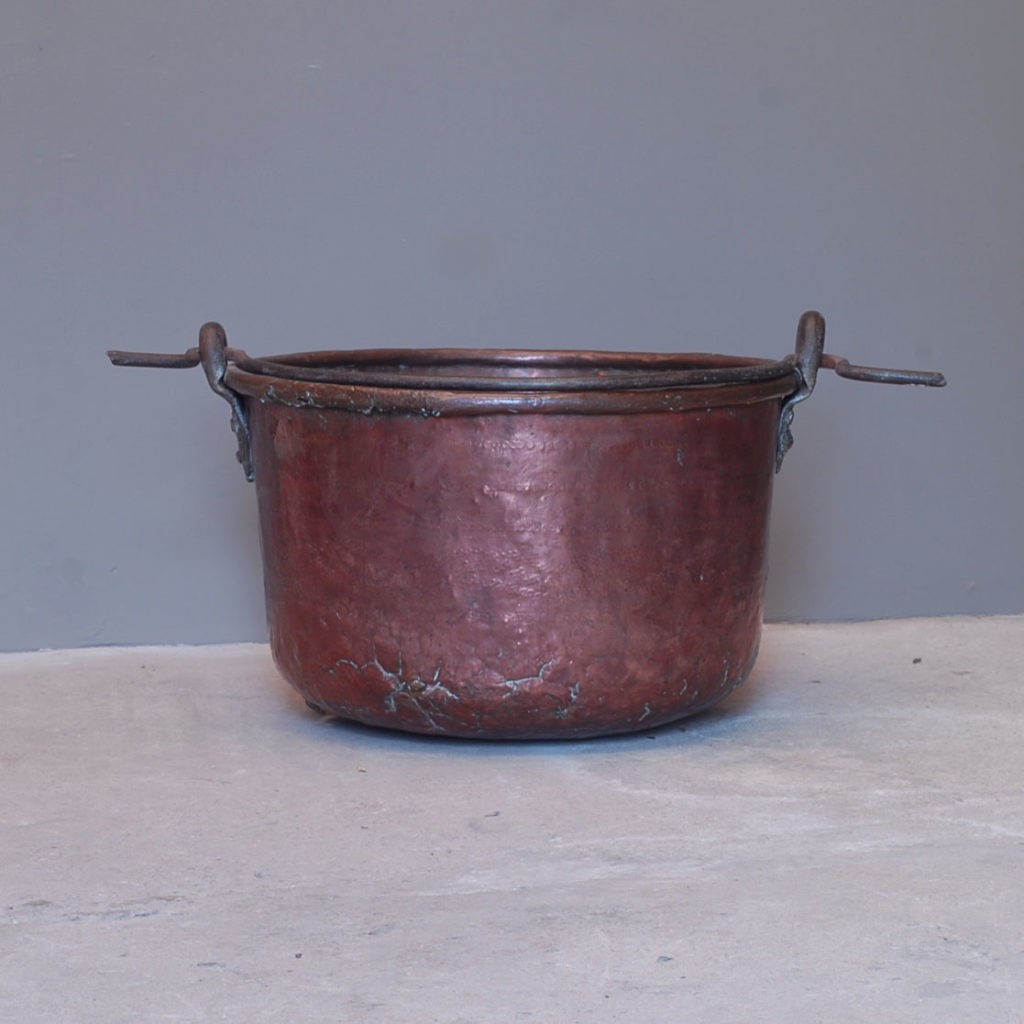 A planished copper and wrought iron cooking pot-137990