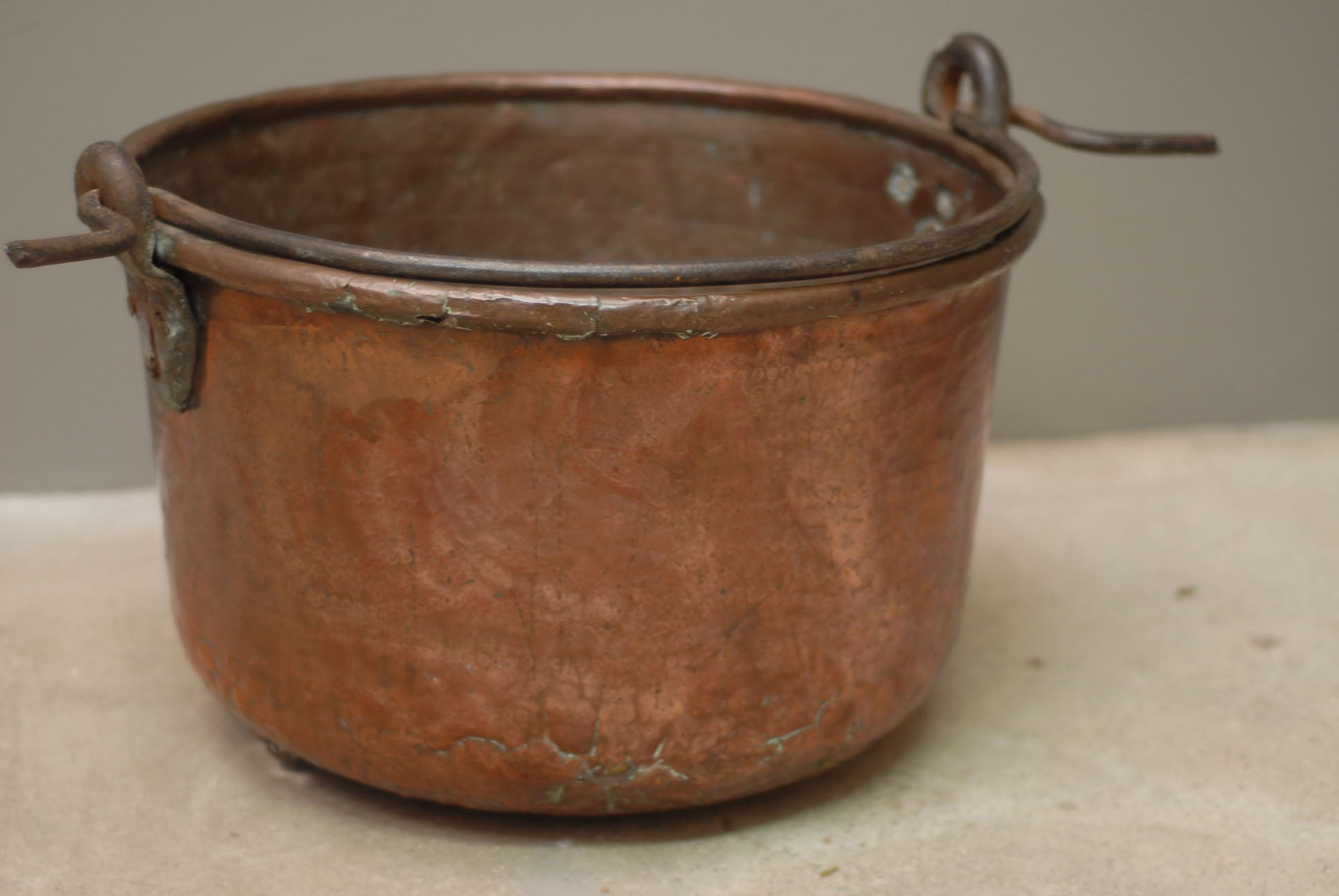 A planished copper and wrought iron cooking pot-137992