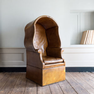 Tan leather upholstered porter's chair,