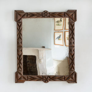 French carved 'tramp-art' wall mirror,