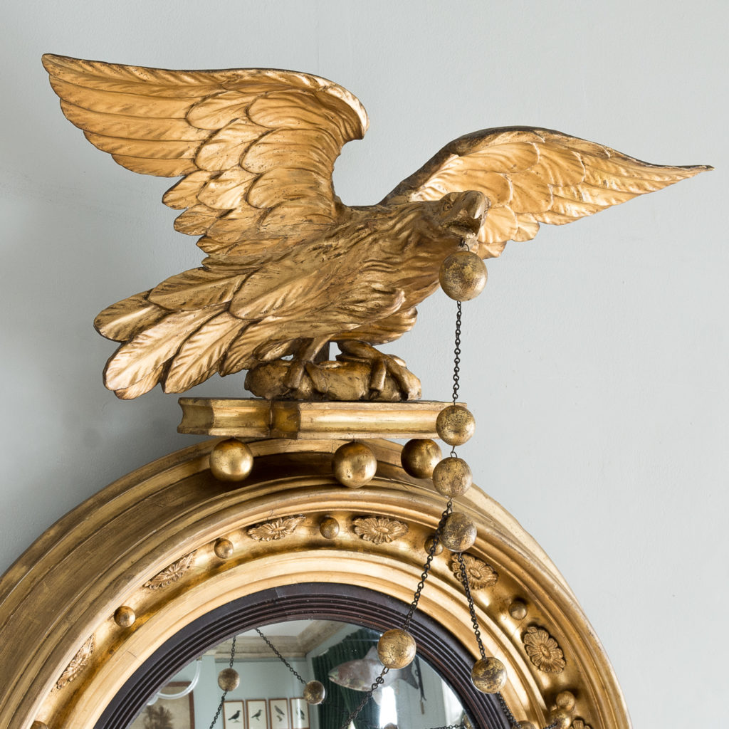 with bold carved eagle surmount,