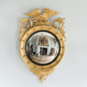 Regency style giltwood convex mirror,