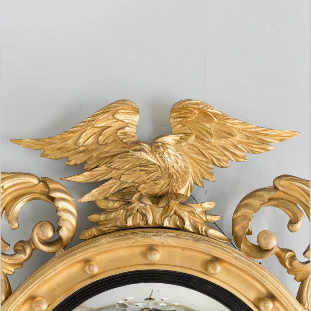 the eagle surmount flanked by scrolled acanthus