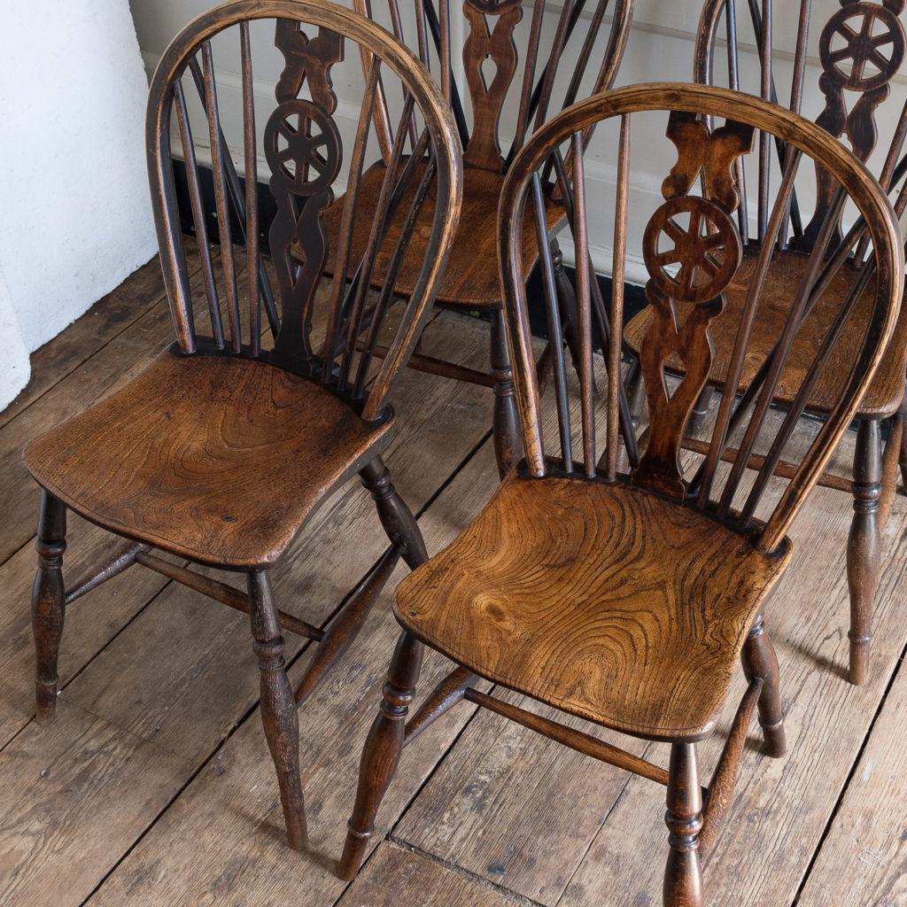Set of four nineteenth century wheelback Windsor chairs,-137954