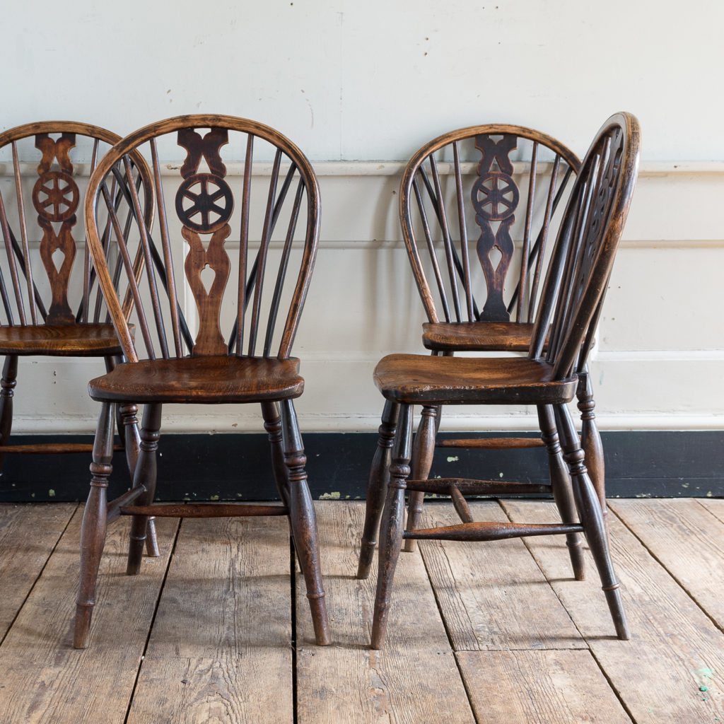 Set of four nineteenth century wheelback Windsor chairs,