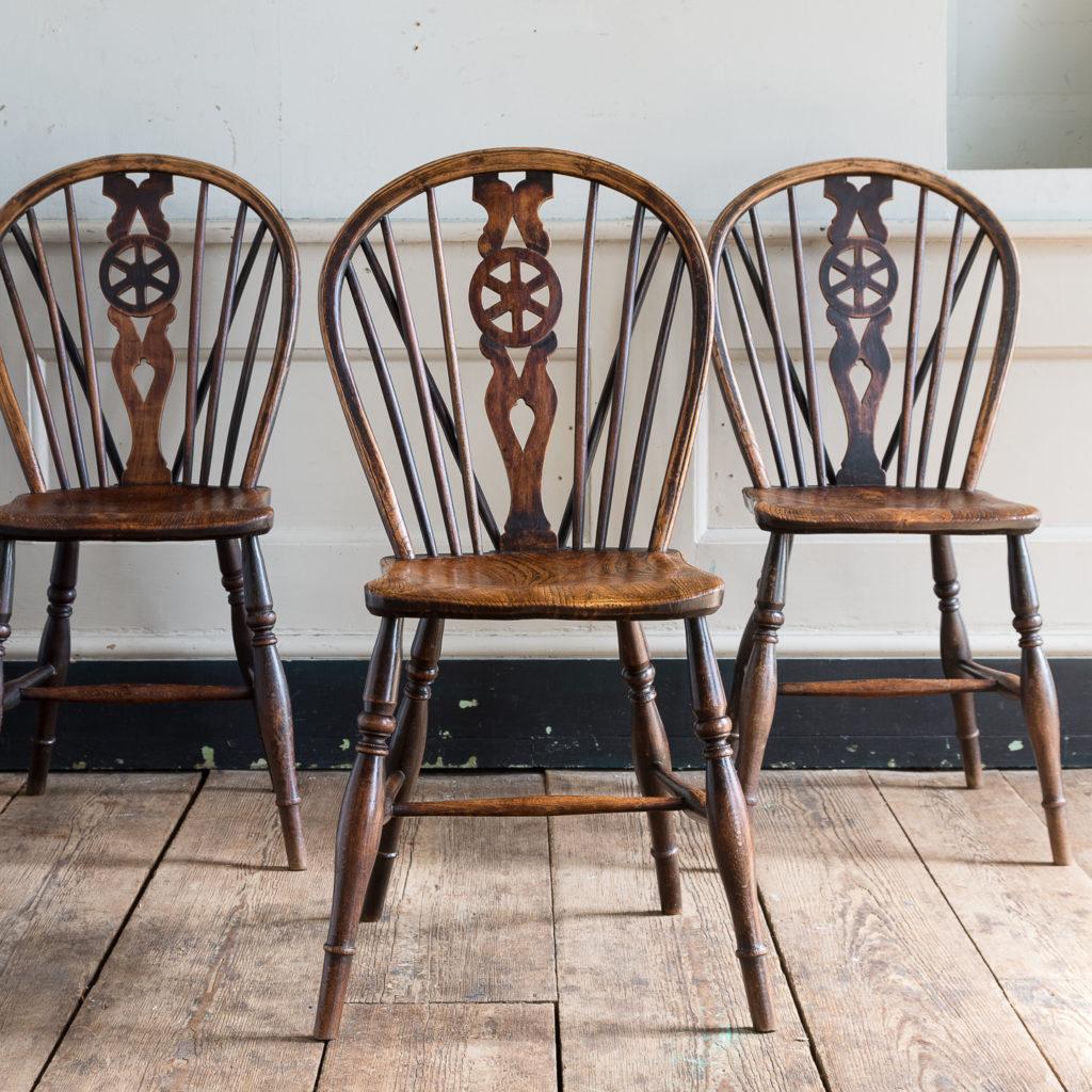 Set of four nineteenth century wheelback Windsor chairs,-137949