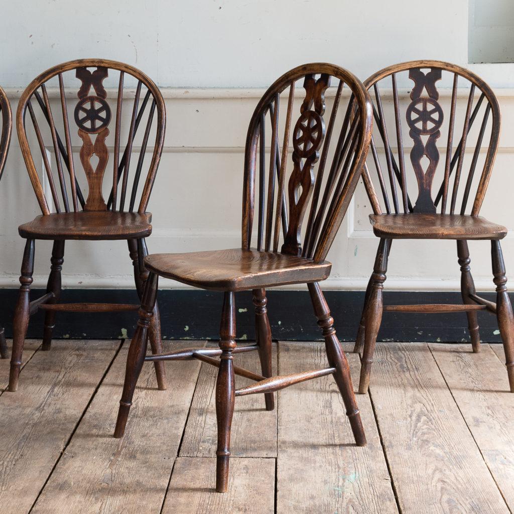 Set of four nineteenth century wheelback Windsor chairs,-137950