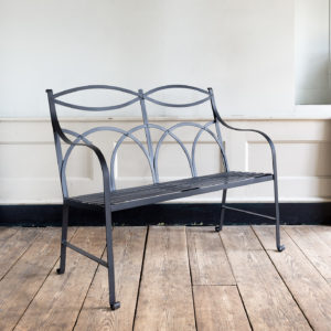 Regency style wrought iron garden bench,