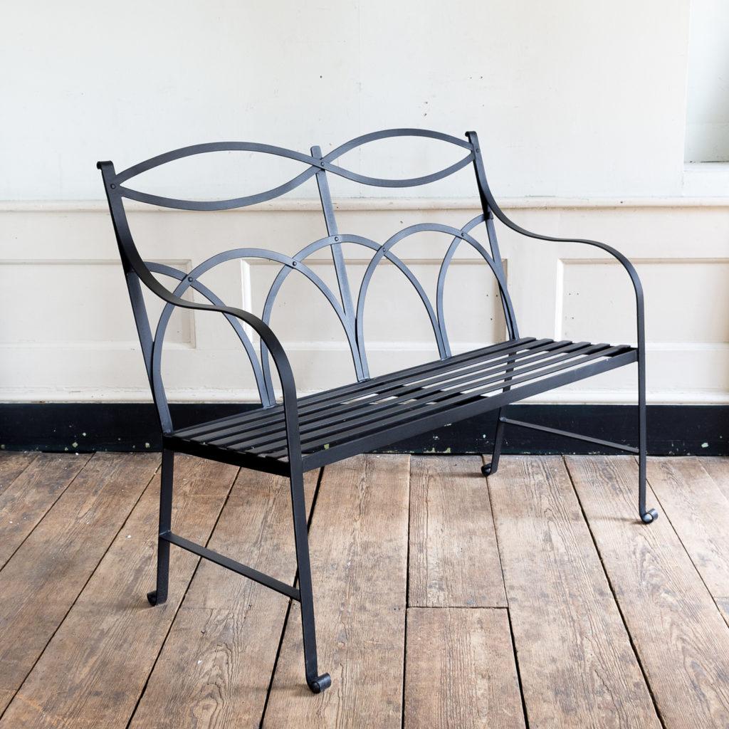 Regency style wrought iron garden bench,