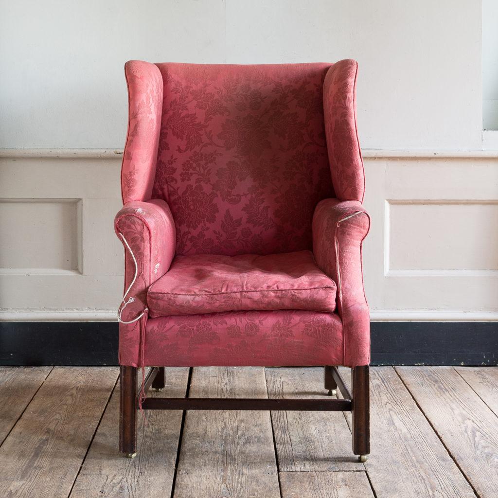 George III mahogany wingback armchair,