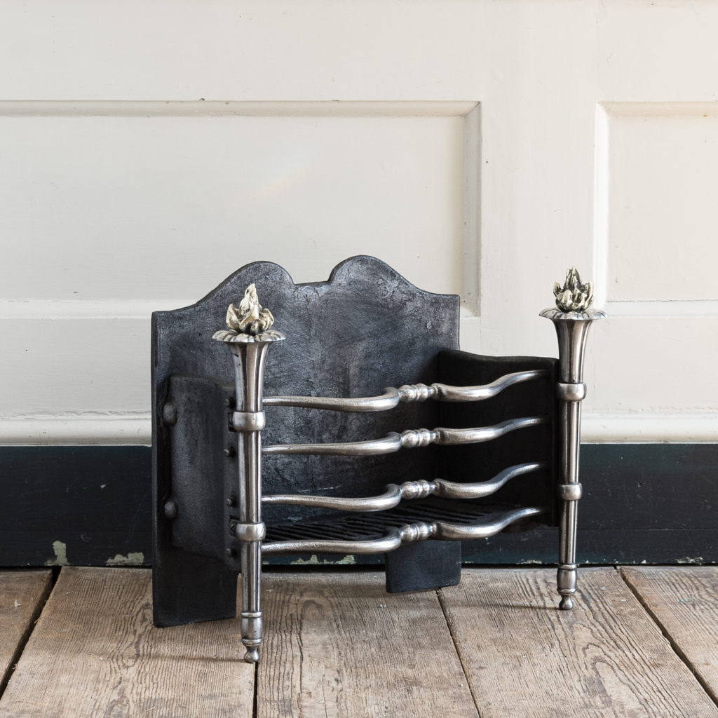 Early twentieth century English iron and brass firebasket,