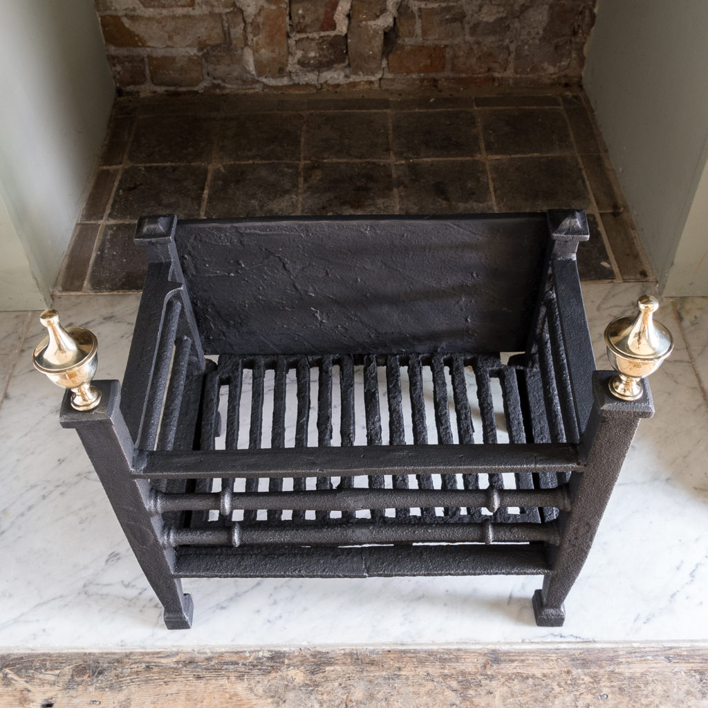 Late nineteenth century iron and brass fire basket,