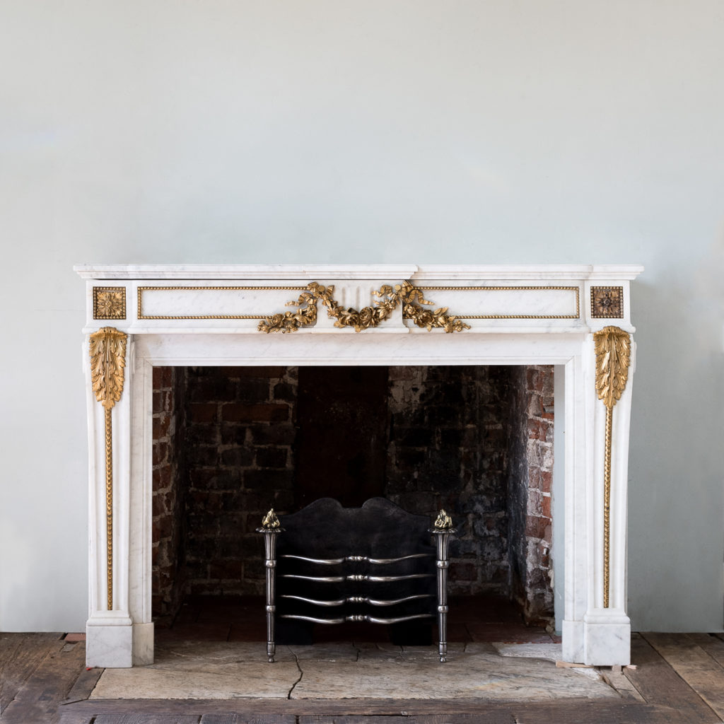 Pair of Louis XVI style Carrara marble and ormolu mounted fireplaces,