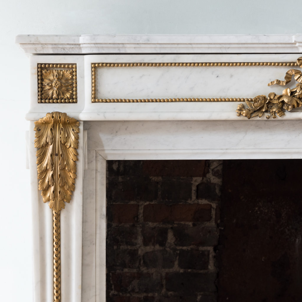 Pair of Louis XVI style Carrara marble and ormolu mounted fireplaces,-138366