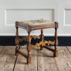 Needlepoint upholstered oak stool