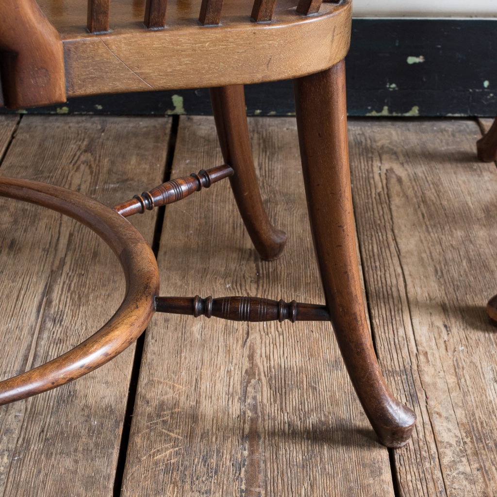 cabriole front and rear legs united by crinoline stretcher