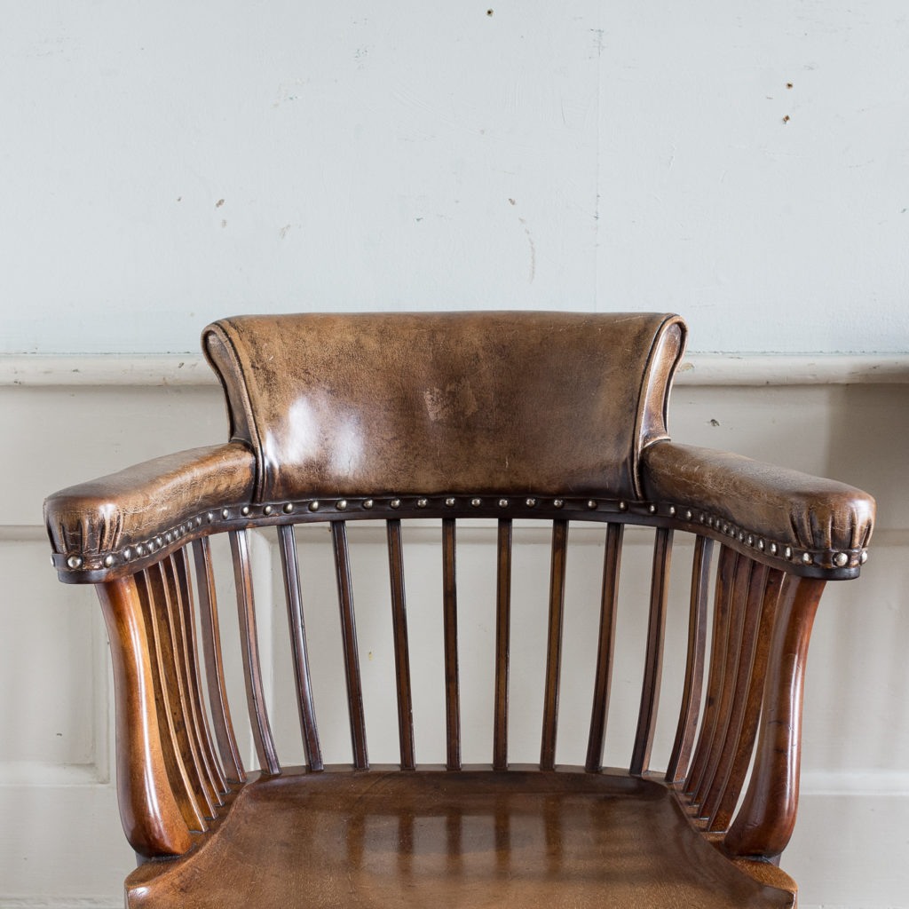 with leather upholstered backrest and arms