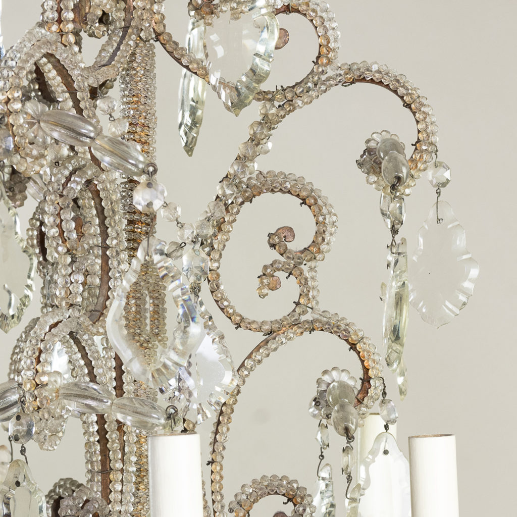 the c-scroll frames with all over beaded glass decoration,